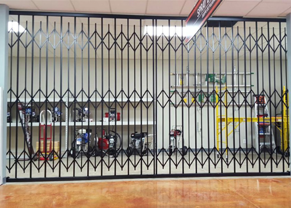 Ju0026J Fence Installed This Interior Iron Bi Parting Folding Security Gate At  Costa Mesau0027s Dunn Edwards Paint Store.