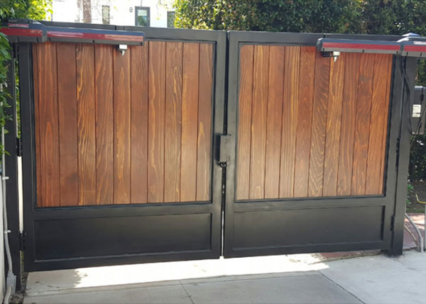 J j wood vinyl fence gallery wooden fence installation for Double wooden driveway gates